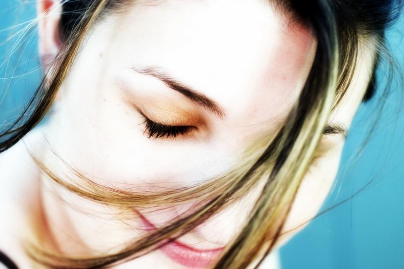 woman eyes closed