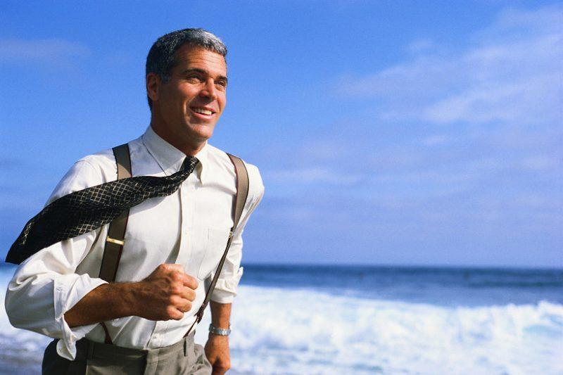 Businessman Running on Beach