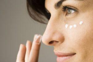 applying-cream-under-the-eyes