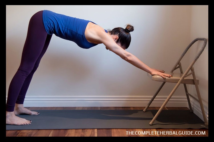 downward facing dog with chair