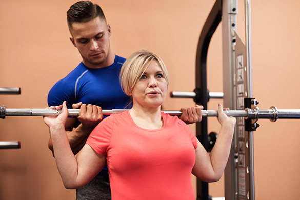 woman-lifting-weights-with-trainer